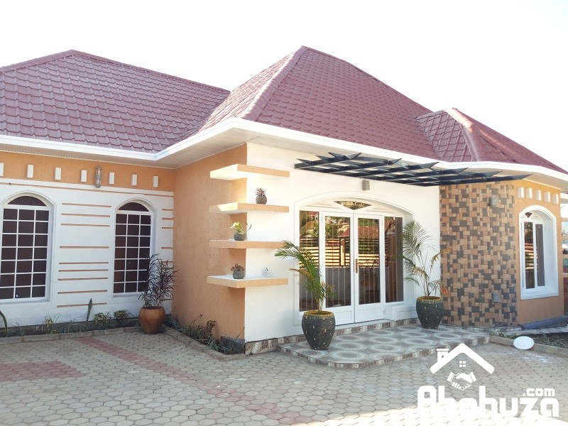 A HOUSE WITH GOOD FINISHING AND NICE LIGHTING ON TARMAC ROAD
