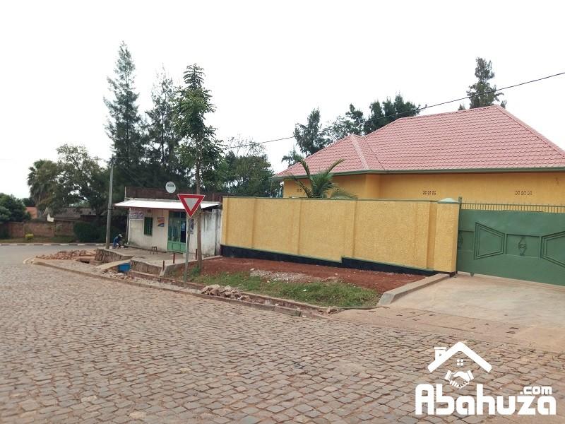 A GOOD FINISHING HOUSE ON THE TARMAC ROAD AT NYAKABANDA